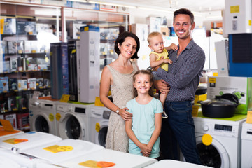 Smiling family of four shopping goods in household