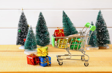Shopping cart with christmas tree and presents
