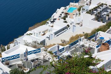 View of Imerovigli village with typical white Greek houses on Santorini island, Greece.