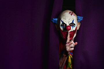 scary evil clown asking for silence Wall mural