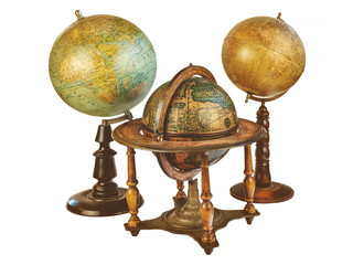 Three ancient world globes isolated on white