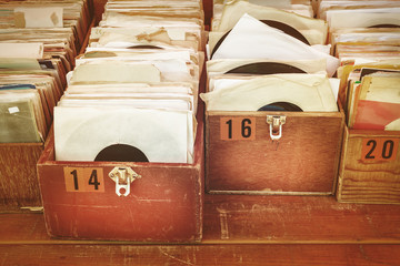 Spoed Foto op Canvas Muziekwinkel Retro styled image of boxes with vinyl turntable records