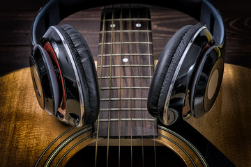Musician Songwriter - Vintage Headphone and Acoustic Guitar.