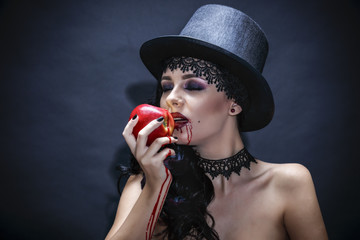 Halloween. Fashion portrait of witch or night vampire woman with