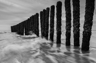 Wall Mural - wave breakers at the sea