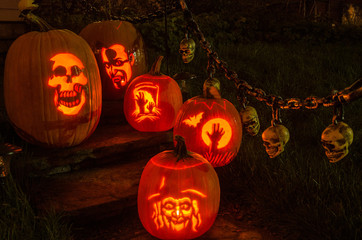 hand carved jack-o-lanterns at night on steps