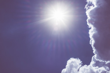 white cloud and light ray behind cloud with blue sky,Vintage fil