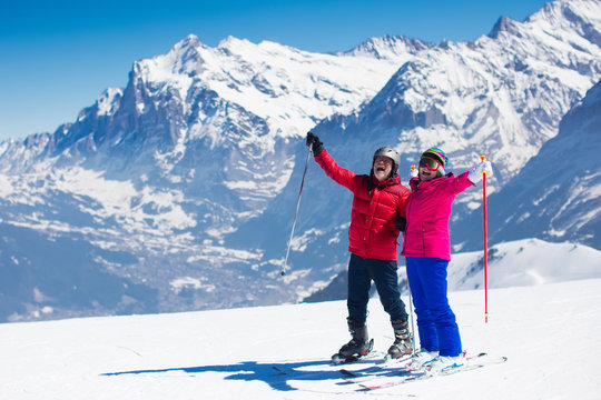 Mature couple skiing in the mountains