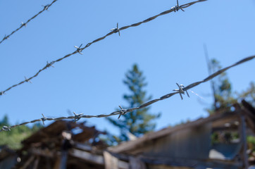 barbed wire on background of blue sky