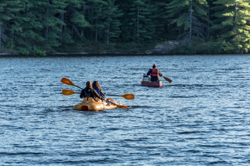 canoeists and kayakers on water