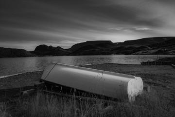 overturned wooden boat