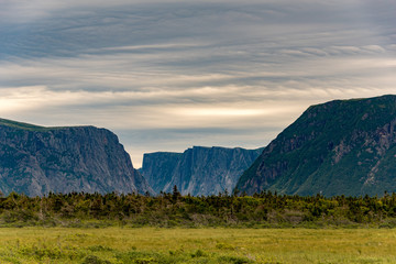 Western Brook Pond cliffs with foreboding sky