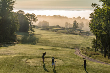 golfers on an early morning