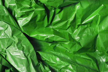 A full page of bright green plastic refuse sack material background texture