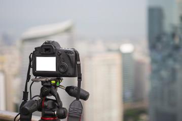 Closeup of a camera on a tripod outdoors