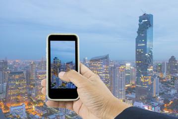 Bangkok skyline cityscape, Thailand. Taking photo on smart phone
