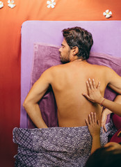 Man receiving back massage at spa