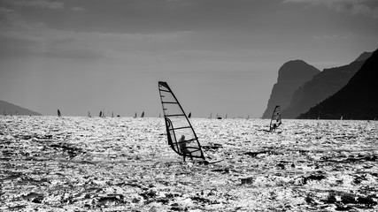 Windsurfing at Garda lake, Italy, bw