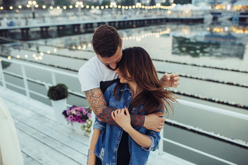 couple posing on the pier