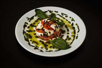 Mozzarella with pesto and basil