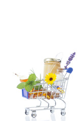 Alternative health care fresh herbal royal jelly and medicinal flower in a supermatket troley