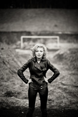 Black and white picture of blonde woman in leather jacket