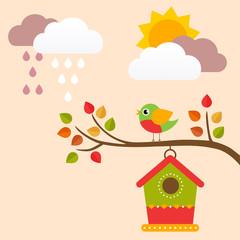 autumn birdhouse on a branch with bird
