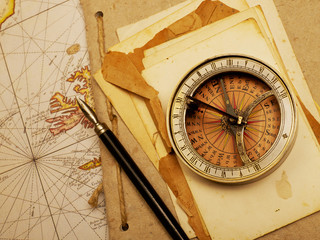Navigational compass and papers