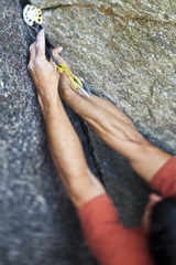 A strong male climber climbs a corner crack, Caboose 10b, Squamish, BC