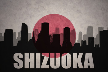 abstract silhouette of the city with text Shizuoka at the vintage japanese flag background