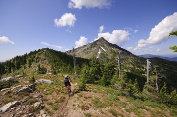 Mountain biking along the Seven Summits trail in Rossland. Kootenay Rockies region, British Columbia, Canada