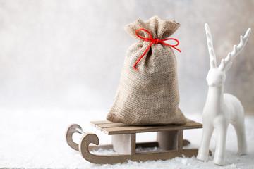Christmas gard. Gift bag with burlap. Christmas decoration.