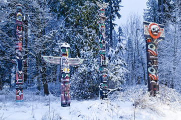 West coast First Nations totems with rare covering of Winter snow, Brockton Point, Stanley Park, Vancouver, British Columbia, Canada