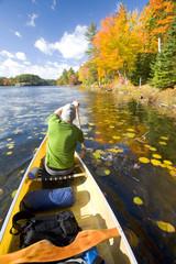 A male paddler on Freeland Lake, Killarney Provincial Park, Ontario, Canada