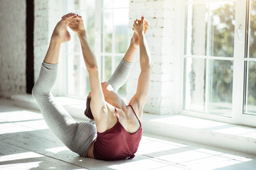 Good looking attractive woman developing flexibility