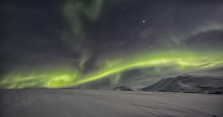 Northern lights or aurora borealis above the snow covered tundra along the Dempster Highway, Yukon.