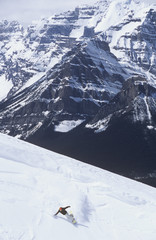 young man backcountry snowboarding at Lake Louise, Alberta, Canada.