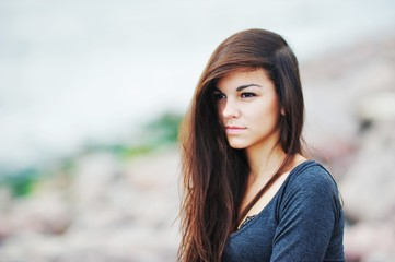 Beautiful long-haired woman on the Gulf of Finland, close-up.
