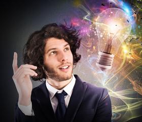 Fototapete - Businessman thinks of a new creative idea