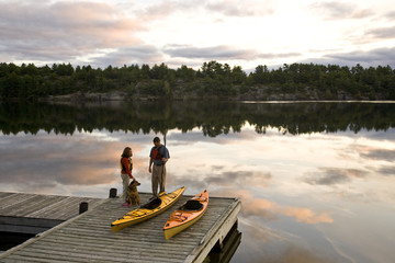 Young couple kayaking on Gull Lake near Gravenhurst, Ontario, Canada.