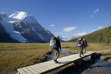 A young family hikes the Robson trail system with the Berg Glacier and Mount Robson in the background, just North of Valemount, in the Thompson Okanagan region, British Columbia, Canada