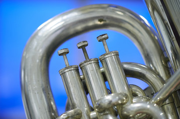 Tuba valves close up against a cool background