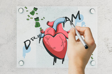 Man drawing money and heart sketch