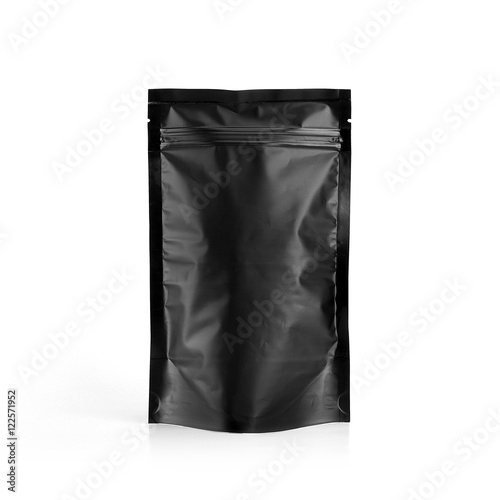 black plastic vacuum sealed pouch coffee bag isolated on white