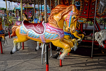 Empty Merry Go Round Carousel Horses at a State Fair