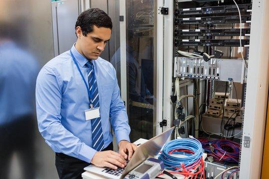 Technician working on laptop