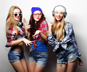 Fashion portrait of three stylish sexy hipster girls best friend