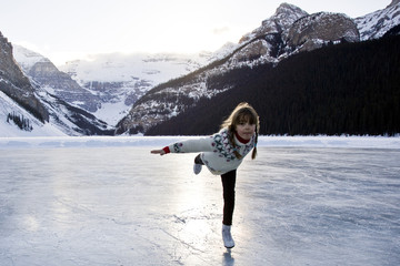 Young girl ice skating at Lake Louise, Banff National Park, Alberta, Canada.