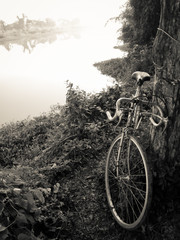 Vintage bicycle style near the river ,black and white image
