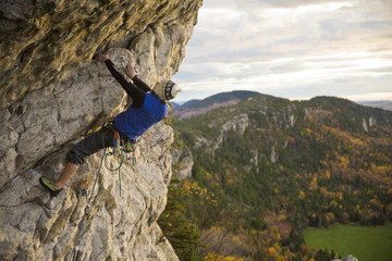 A young man climbs the popular route Moby Dick 5.11b, Kamouraska, QC